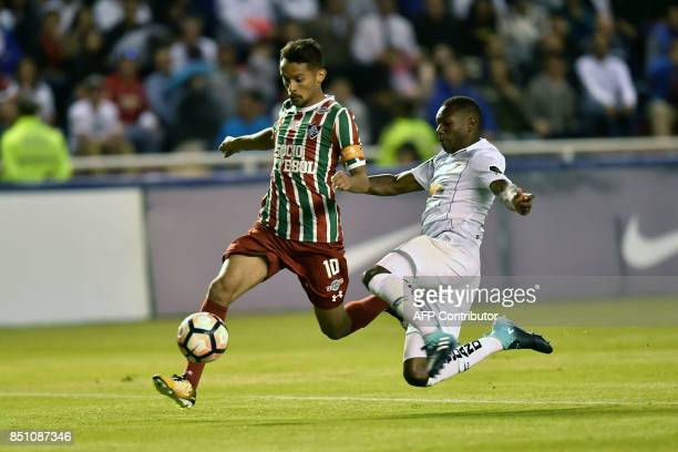 Brazil's Fluminense player Gustavo Scarpa vies for the ball with Ecuador's Liga de Quito Anibal Chala during their 2017 Sudamericana Cup football...