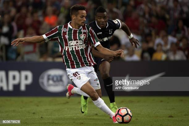 Brazil's Fluminense player Gustavo Scarpa vies for the ball with Franklin Carabali of Ecuador's Universidad Catolica during their 2017 Copa...