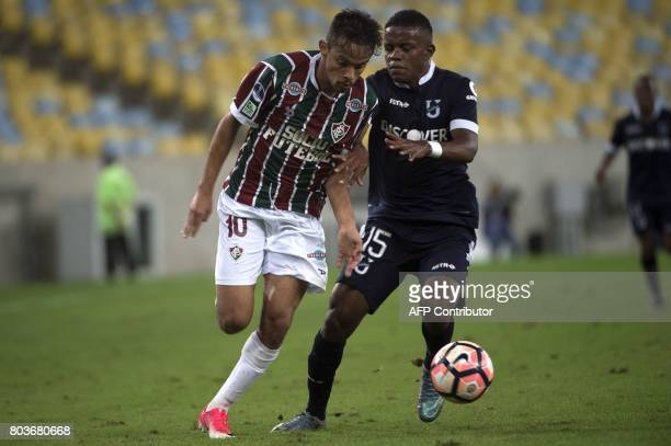 Brazil's Fluminense player Gustavo Scarpa vies for the ball with Gustavo Cortez of Ecuador's Universidad Catolica during their 2017 Copa Sudamericana...