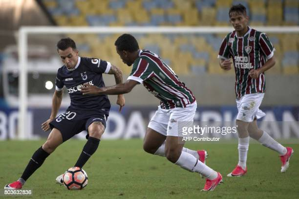 Brazil's Fluminense player Wendel vies for the ball with Matias Defederico of Ecuador's Universidad Catolica during their 2017 Copa Sudamericana...