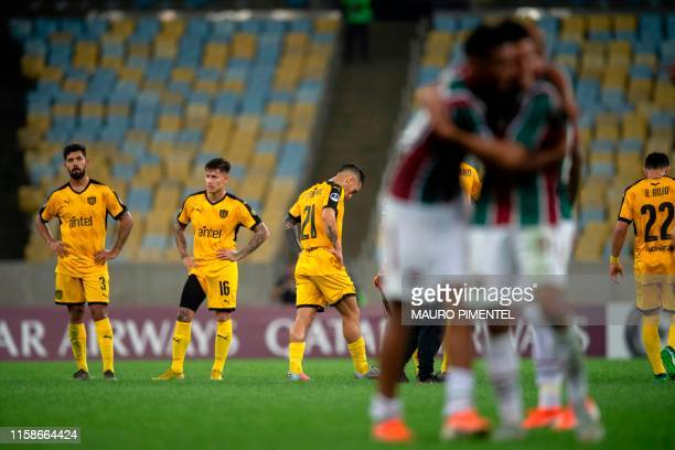TOPSHOT Brazil's Fluminense players celebrate after winning a Copa Sudamericana football match against Uruguay's Penarol at the Maracana stadium in...