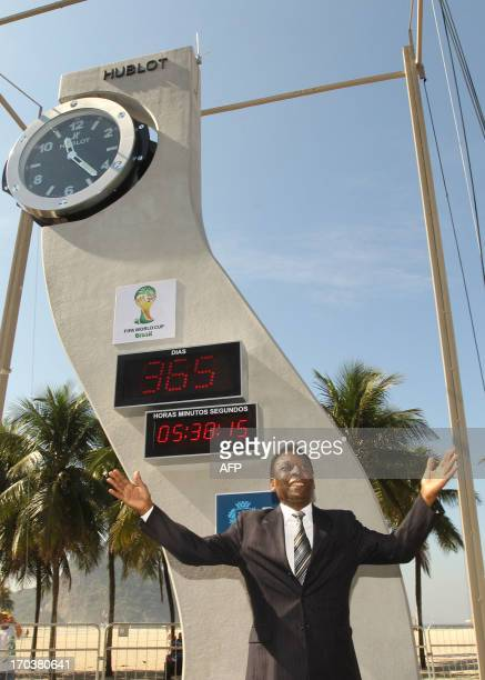 Brazil's football legend Pelé pose after the ceremony of the unveiling clock designed by the late star architect Oscar Niemeyer to mark the oneyear...