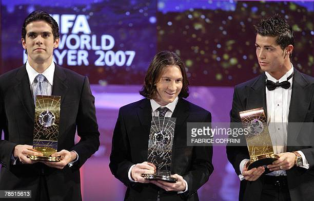 Brazil's football player Kaka holds the trophy of FIFA Player of the Year as he poses with Argentine's football player Lionel Messi and Portugal's...