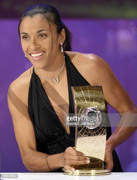 Brazil's football player Marta holds the trophy of FIFA women's Player of the Year during the FIFA World Player Gala 2007 award ceremony 17 December...