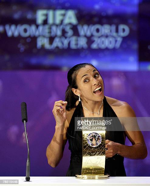 Brazil's football player Marta reacts with her trophy of FIFA women's player of the year during the FIFA World Player Gala 2007 award ceremony 17...