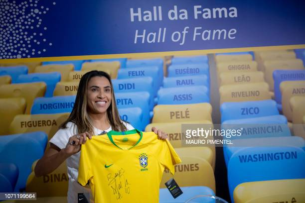 Brazil's football player Marta Vieira da Silva commonly known as Marta poses for pictures during a ceremony in which her footprints will be added to...