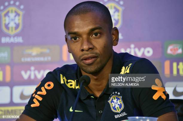 Brazil's football team player Fernandinho speaks during a press conference after a training session at the Arena Dunas stadium in Natal, Brazil on...