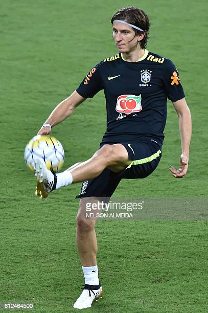 Brazil's football team player Filipe Luis takes part in a training session at the Arena Dunas stadium in Natal, Brazil on October 4, 2016. Brazil...