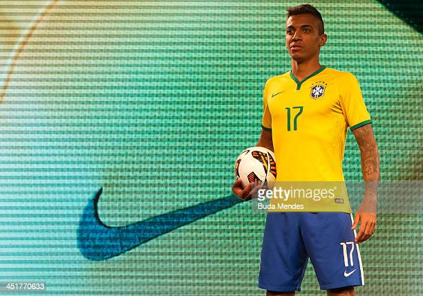 Brazil's football team player Luiz Gustavo poses for pictures during the presentation of the new uniform for Brazil 2014 FIFA World Cup on November...