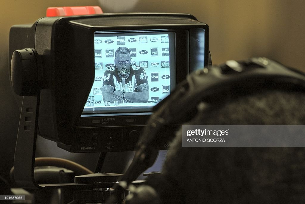 Brazil's football team player Maicon appears on a tv monitor as he answers questions during a press conference on June 5, 2010 in Johannesburg ahead of the start of the 2010 World Cup in South Africa.