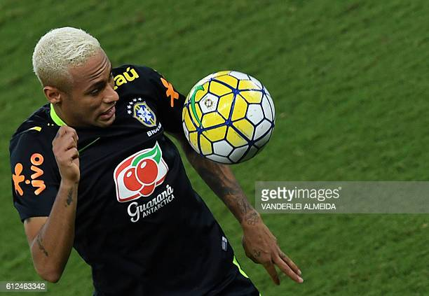 Brazil's football team player Neymar takes part in a training session at the Arena Dunas stadium in Natal, Brazil on October 4, 2016. Brazil will...