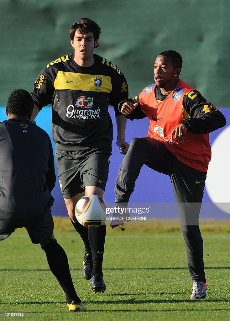 Brazil's football team player Robinho (R) controls the ball next to teammate Kaka during a training session at the Randburg High School on June 5, 2010 in Johannesburg. The team is preparing to compete in the 2010 FIFA World Cup in South Africa.