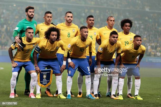 Brazil's football team players goalkeeper Alisson Marquinhos Renato Augusto Paulinho Miranda and Willian and Dani Alves Marcelo Neymar Casemiro and...