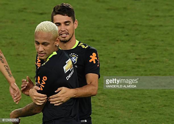 Brazil's football team players Neymar and Oscar take part in a training session at the Arena Dunas stadium in Natal, Brazil, on October 4, 2016 ahead...