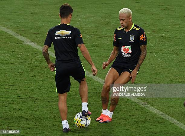 Brazil's football team players Neymar and Philippe Coutinho take part in a training session at the Arena Dunas stadium in Natal Brazil on October 4...