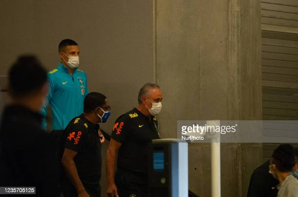 Brazil's football team Tite as members of the Brazil federation of football team board their bus at the Grand Hyatt Hotel in Bogota, Colombia to be...