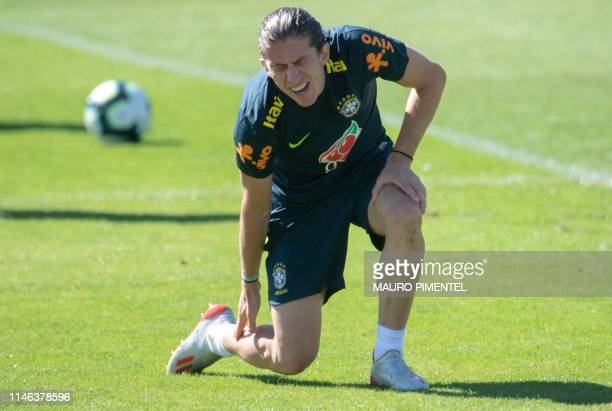 Brazil's footballer Filipe Luis gestures during a training session of the national team at the Granja Comary sport complex in Teresopolis Brazil on...