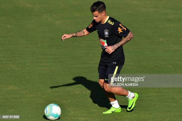 Brazil's footballer Philippe Coutinho takes part in a training session at the Corinthians team training centre in Sao Paulo Brazil on March 21 2017...
