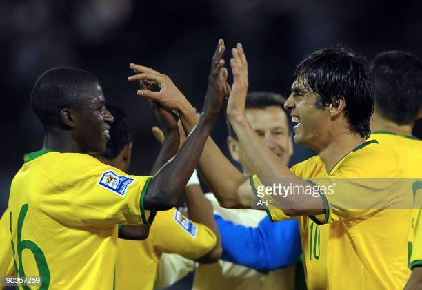 Brazil's footballers Dunga and Ramires celebrate after winning their FIFA World Cup South Africa-2010 qualifier football match against Argentina at...