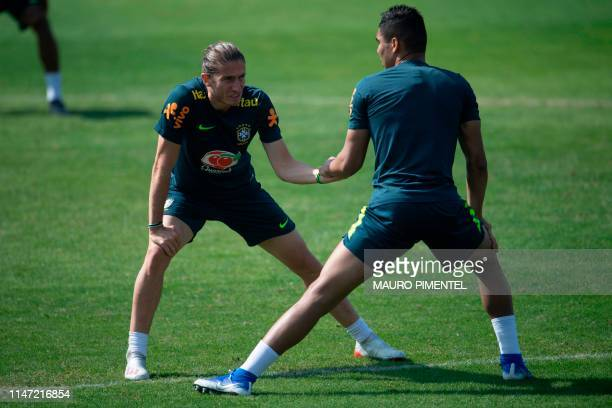 Brazil's footballers Filipe Luis and Casemiro take part in a training session of the national team at the Granja Comary sport complex in Teresopolis...