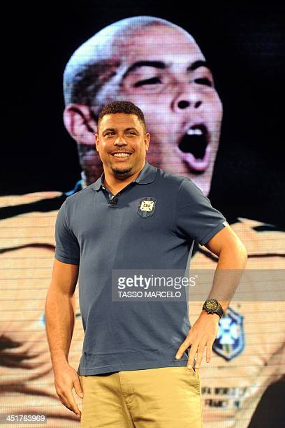 Brazil's former football star Ronaldo poses for a picture during the presentation of the new uniform for Brazil 2014 FIFA World Cup on November 24...