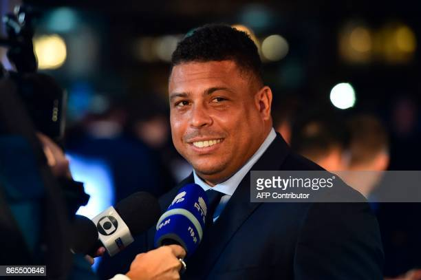 Brazil's former player Ronaldo Luis Nazario de Lima gives an interview as he arrives for The Best FIFA Football Awards ceremony on October 23 2017 in...