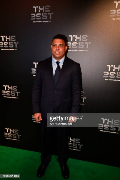 Brazil's former player Ronaldo Luis Nazario de Lima poses for a photograph as he arrives for The Best FIFA Football Awards ceremony on October 23...