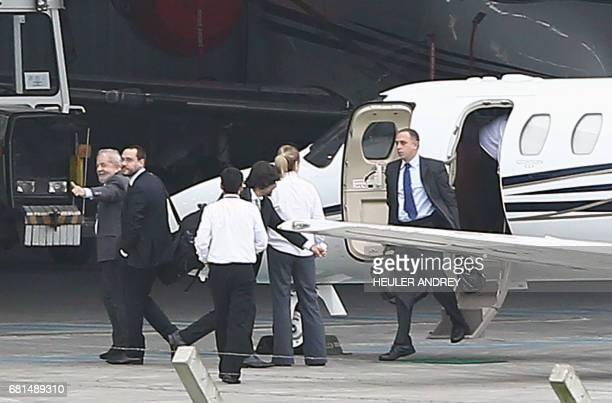 "Brazil's former president Luiz Inacio Lula da Silva arrives at the Afonso Pena airport in Curitiba, Brazil for a hearing with senior ""Car Wash"" Judge..."