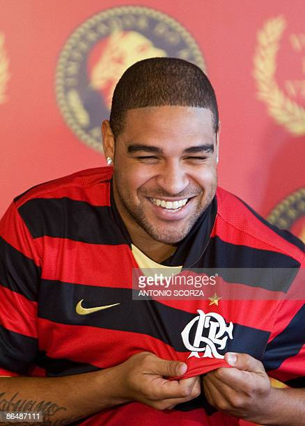 Brazil's forward Adriano holds a Flamengo's jersey on May 7 during his presentation as new player of the Brazilian football team in Rio de Janeiro...