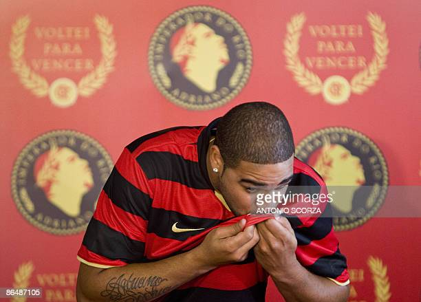 Brazil's forward Adriano kisses a Flamengo's jersey on May 7 during his presentation as new player of the Brazilian football team in Rio de Janeiro...