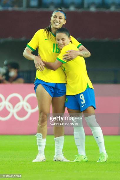 Brazil's forward Beatriz celebrates with Brazil's midfielder Debinha after their win in the Tokyo 2020 Olympic Games women's group F first round...