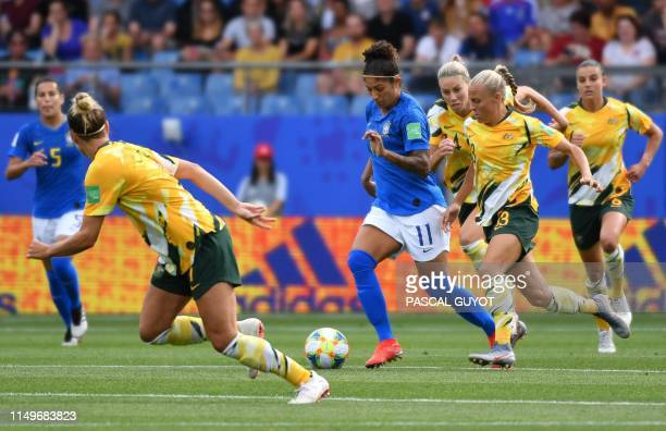 Brazil's forward Cristiane vies for the ball with Australia's midfielder Tameka Yallop during the France 2019 Women's World Cup Group C football...