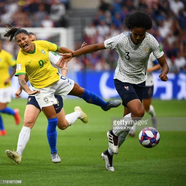 TOPSHOT Brazil's forward Debinha vies with France's defender Wendie Renard during the France 2019 Women's World Cup round of sixteen football match...