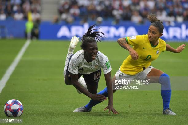 TOPSHOT Brazil's forward Debinha vies with France's forward Viviane Asseyi during the France 2019 Women's World Cup round of sixteen football match...
