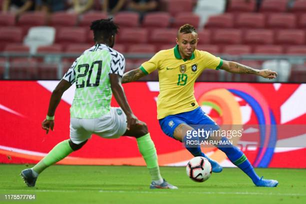 Brazil's forward Everton fights for the ball with Nigeria's defender Chidozie Awaziem during an international friendly football match between Brazil...
