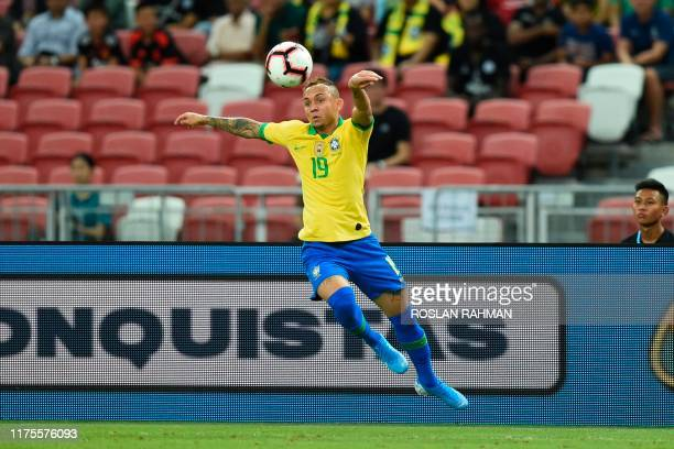 Brazil's forward Everton heads the ball during an international friendly football match between Brazil and Nigeria at the National Stadium in...