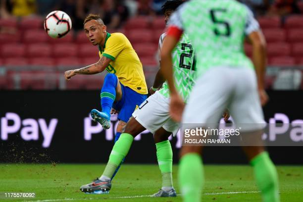 Brazil's forward Everton kicks the ball during an international friendly football match between Brazil and Nigeria at the National Stadium in...