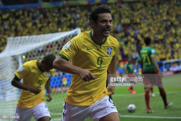 Brazil's forward Fred celebrates after scoring a goal during the Group A football match between Cameroon and Brazil at the Mane Garrincha National...