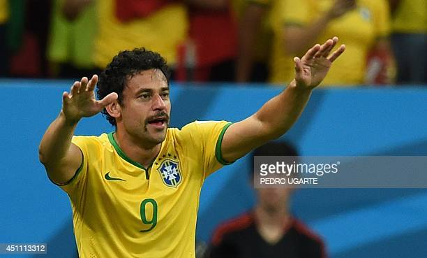 Brazil's forward Fred celebrates after scoring during a Group A football match between Cameroon and Brazil at the Mane Garrincha National Stadium in...