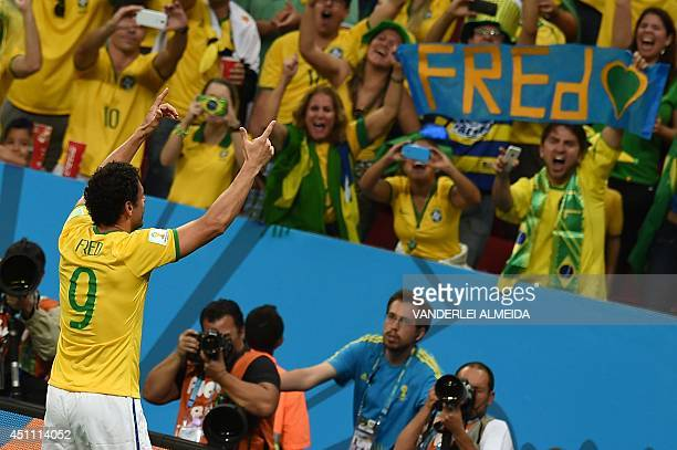 Brazil's forward Fred celebrates after scoring their third goal during the Group A football match between Cameroon and Brazil at the Mane Garrincha...