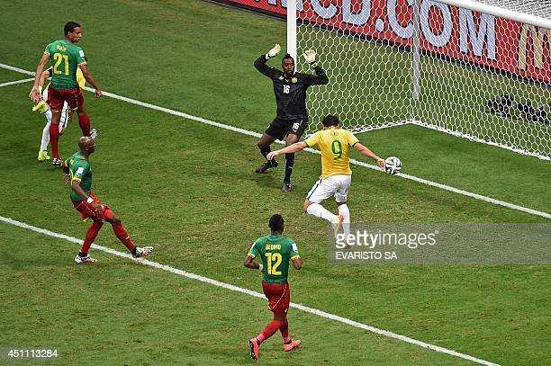 Brazil's forward Fred scores a goal as Cameroon's goalkeeper Charles Itandje fails to defend during the Group A football match between Cameroon and...