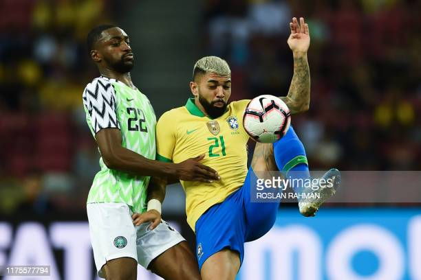 Brazil's forward Gabriel Barbosa and Nigeria's defender Adesewo Ajayi fight for the ball during an international friendly football match between...