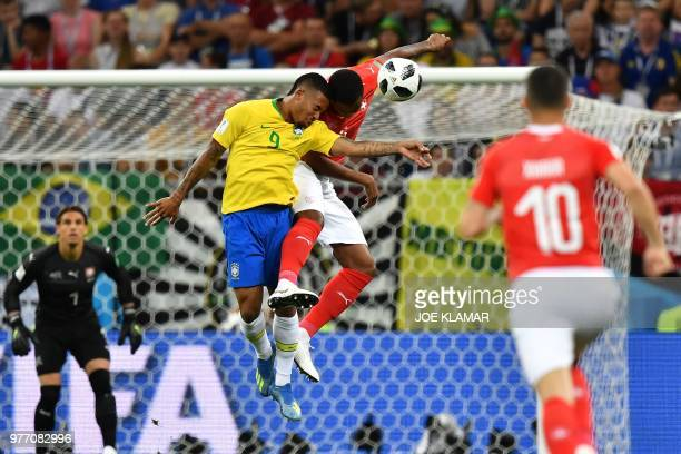 TOPSHOT Brazil's forward Gabriel Jesus and Switzerland's defender Manuel Akanji compete for the ball during the Russia 2018 World Cup Group E...