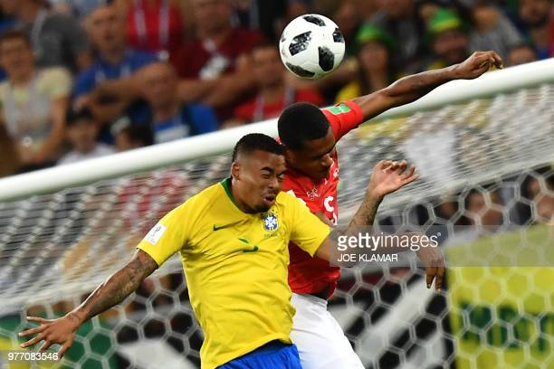 Brazil's forward Gabriel Jesus and Switzerland's defender Manuel Akanji compete for the ball during the Russia 2018 World Cup Group E football match...