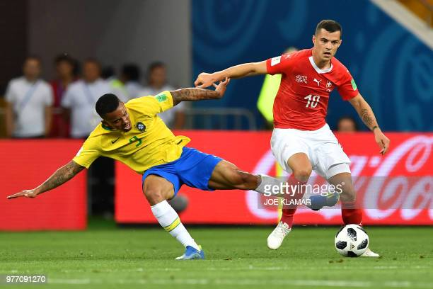 TOPSHOT Brazil's forward Gabriel Jesus and Switzerland's midfielder Granit Xhaka compete for the ball during the Russia 2018 World Cup Group E...