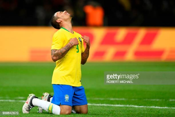 Brazil's forward Gabriel Jesus celebrates after scoring a goal during the international friendly football match between Germany and Brazil in Berlin...