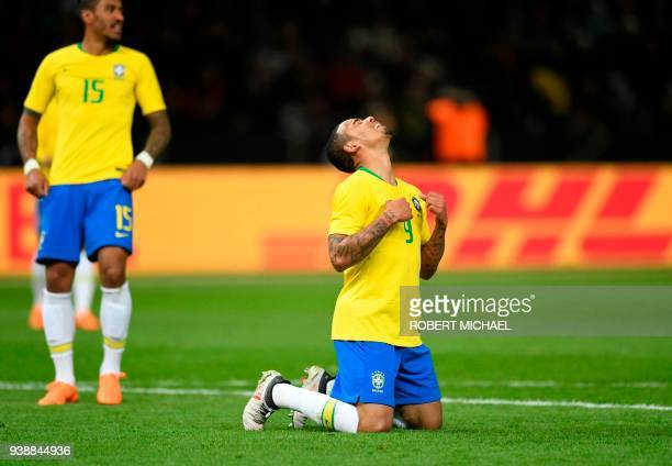 TOPSHOT Brazil's forward Gabriel Jesus celebrates after scoring a goal next to Brazil's midfielder Paulinho during the international friendly...