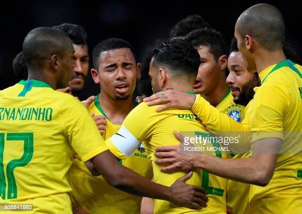Brazil's forward Gabriel Jesus celebrates with teammates after scoring during their international friendly football match between Germany and Brazil...