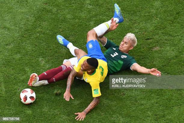 Brazil's forward Gabriel Jesus falls on Mexico's defender Carlos Salcedo during the Russia 2018 World Cup round of 16 football match between Brazil...