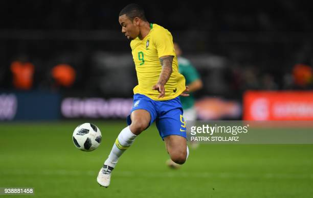 Brazil's forward Gabriel Jesus plays the ball during their international friendly football match between Germany and Brazil in Berlin on March 27...